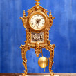 Ancient vintage golden brass pendulum clock — Stock Photo #7004076