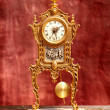 Ancient vintage golden brass pendulum clock - Stok fotoraf