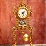 Ancient vintage golden brass pendulum clock — Stock Photo