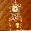 Ancient vintage golden brass pendulum clock — Stock Photo #7004102