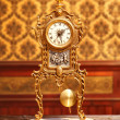 Ancient vintage brass pendulum clock — Stock Photo #7004120