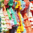 Colorful gipsy dresses in rack hanged in Spain — Stock Photo #7004149