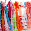 Colorful gipsy dresses in rack hanged in Spain — Stock Photo #7004161