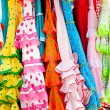 Colorful gipsy dresses in rack hanged in Spain — Stock Photo #7004174