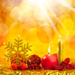 Christmas golden snowflake with red candles - Stock Photo