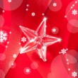 Christmas glass star on red ribbon - Lizenzfreies Foto