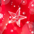 Christmas glass star on red ribbon - Foto Stock
