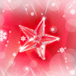 Christmas glass star on red ribbon - Stock Photo