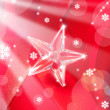 Christmas glass star on red ribbon — Stock Photo