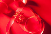 Christmas red gift ribbon background — Stock Photo