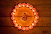 Chirstmas candles circle over wood and symbol — Stock Photo