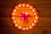 Chirstmas candles circle over wood and symbol — Stock Photo