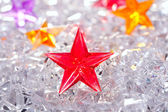 Christmas red glass star on winter ice — Stock Photo