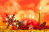 Boże Narodzenie czerwony śnieżynka z świece — Zdjęcie stockowe