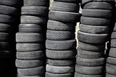 Car tires pneus stacked in rows — Stock Photo