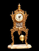 Ancient vintage brass pendulum clock — Stock Photo