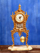 Ancient vintage golden brass pendulum clock — Stock Photo