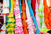 Colorful gipsy dresses in rack hanged in Spain — Stock Photo