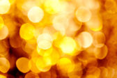 Abstract golden blurred lights background — Foto Stock