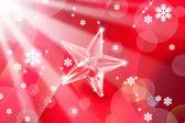 Navidad de cristal estrella en cinta roja — Foto de Stock