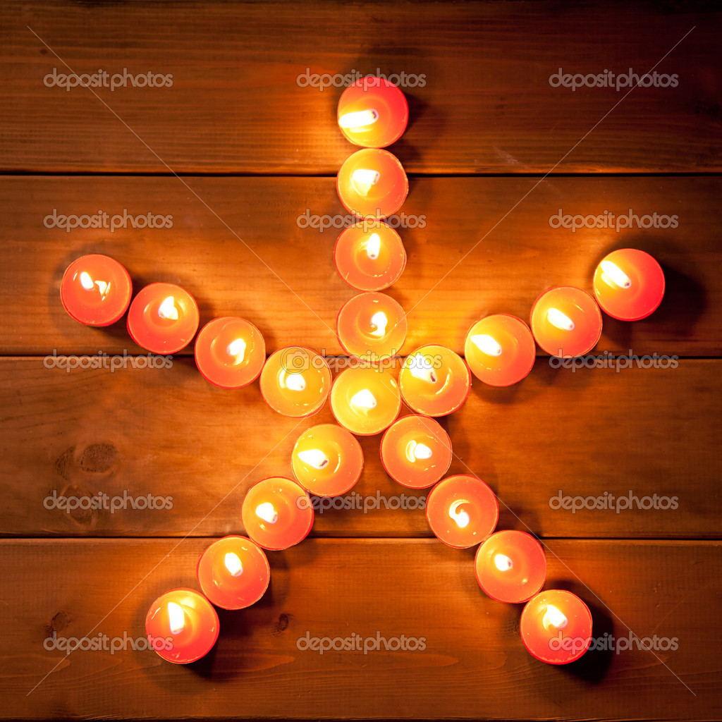 Christmas candles pentagram star on golden warm wood — Stock Photo #7000560