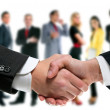 Business handshake and company team — Stock Photo