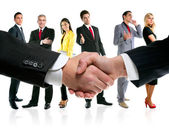 Equipo de apretón de manos y la empresa de negocios — Foto de Stock