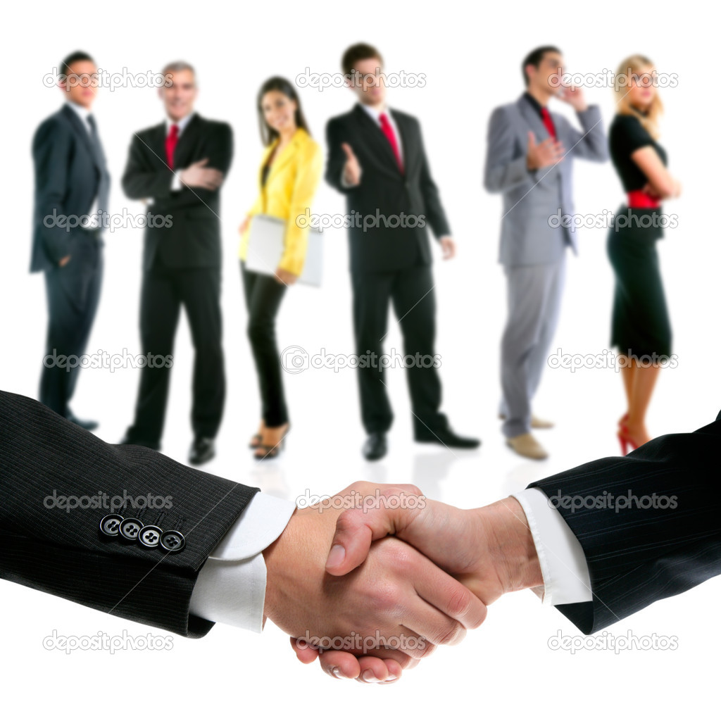 Business handshake with company team in background  Stock Photo #7021404