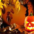 Stockfoto: Halloween orange pumpkin on autumn leaves
