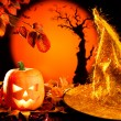 Halloween orange pumpkin on autumn leaves — Stock Photo #7044021