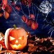 Royalty-Free Stock Photo: Halloween lantern pumpkin  in dark sky clouds