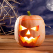 Halloween lantern pumpkin  in dark sky clouds - Stock Photo