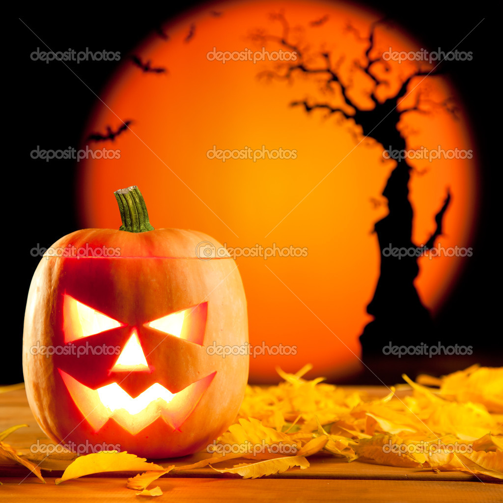 Halloween orange pumpkin lantern with autumn leaves  Foto de Stock   #7047009