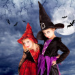 Halloween costumes kid girls on moon night — Stock Photo #7091836