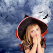 Halloween scared kid girl on dark moon sky — Stock Photo #7091872