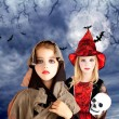 Halloween kid girls with skull cloudy moon — Stock Photo #7091927