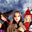 Halloween kid girls and pumpkin in moon sky — Stock Photo #7091972