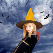 Beautiful blond halloween kid girl in moon sky — Stock Photo #7091996