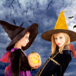 Halloween kid girls and pumpkin in moon sky — Stock Photo