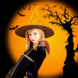 Halloween beautiful girl in dried tree bat — Stock Photo #7092122