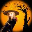 Halloween beautiful girl in dried tree bat — Stock Photo #7092167
