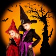 Halloween children girls with tree and bats — Stock Photo #7092395