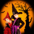 Halloween children girls with tree and bats — Stock Photo