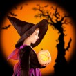 Halloween children girl holding pumpkin — Stock Photo