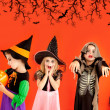 Foto Stock: Halloween group of children girls costumes