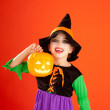 Stock Photo: Halloween kid girl costume on orange