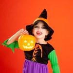Halloween kid girl costume on orange — Stock Photo
