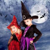 Halloween costumes kid girls on moon night — Stock Photo