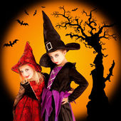Halloween children girls with tree and bats — 图库照片