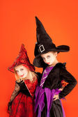 Halloween sister kid girls on orange — Stockfoto